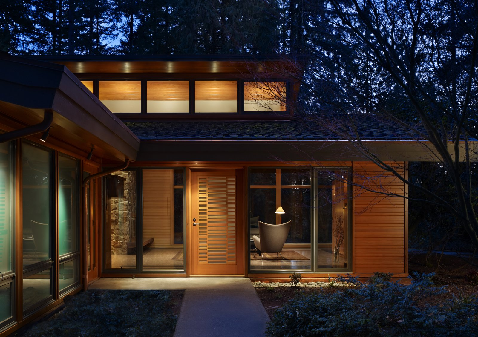 Exterior, House Building Type, Gable RoofLine, Wood Siding Material, and Shingles Roof Material Exterior view of main entry  Lake  Forest Park Mid Century Renovation by FINNE Architects