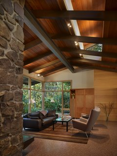 View of living area with new clerestory windows, wood paneling and casework.