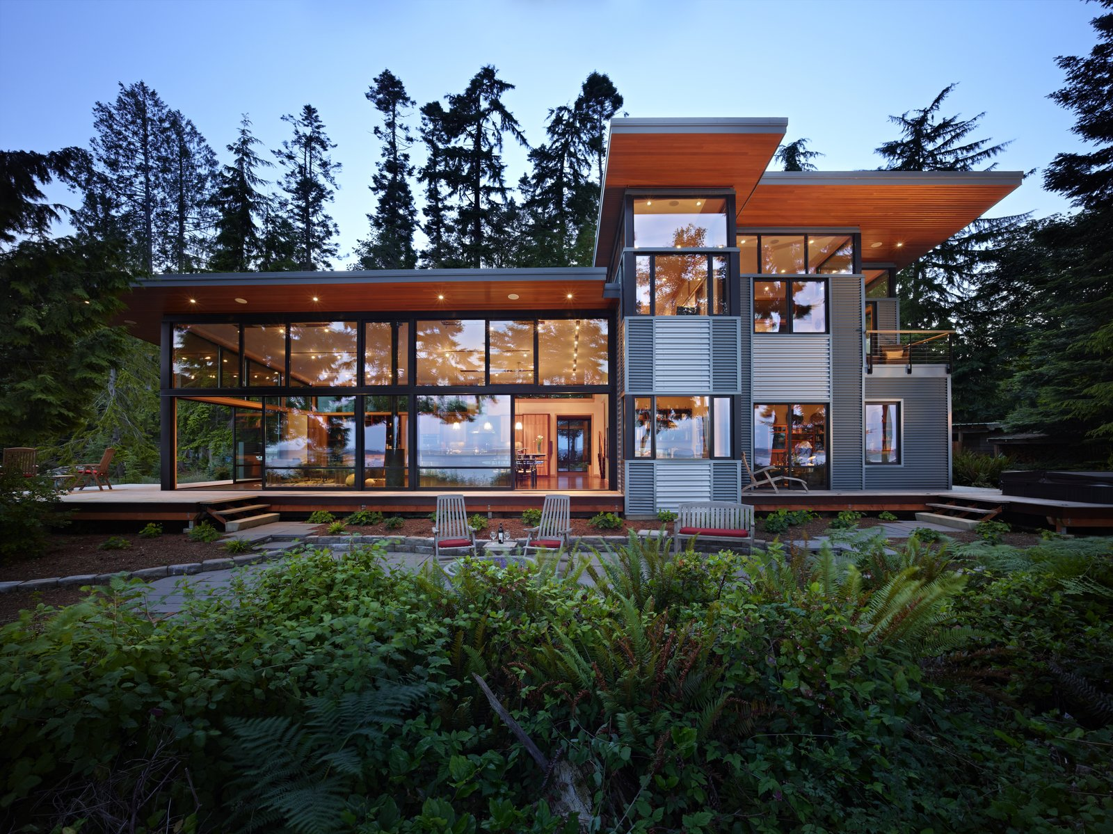 Exterior, House Building Type, Shed RoofLine, Metal Roof Material, and Metal Siding Material Exterior view of house on the east side, toward the Hood Canal  Port Ludlow House by FINNE Architects