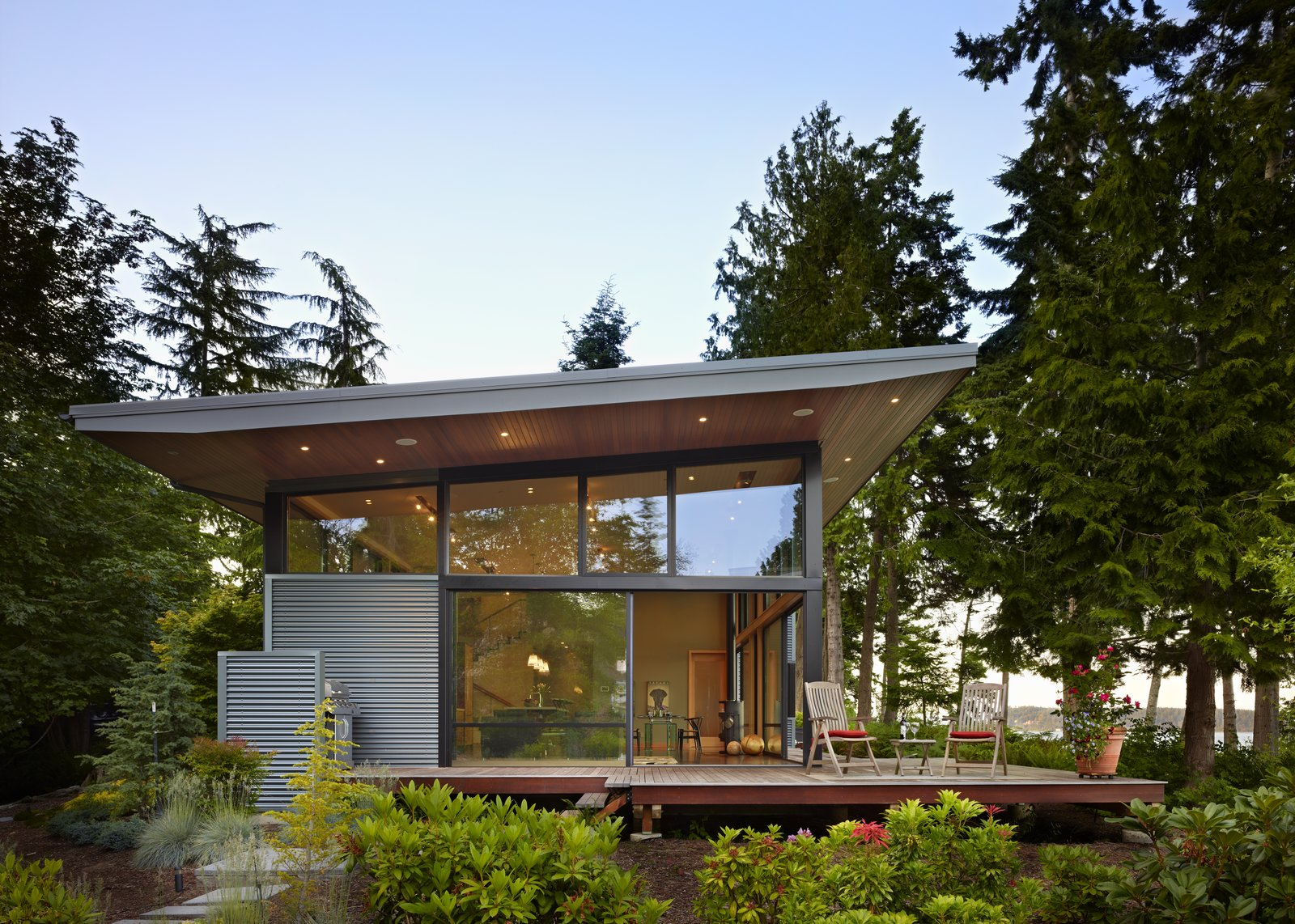 Exterior, Metal, House, Shed, Metal, and Glass South side of house, with 6-ft roof overhangs and large sliding glass panels  Best Exterior Metal Photos from Port Ludlow House