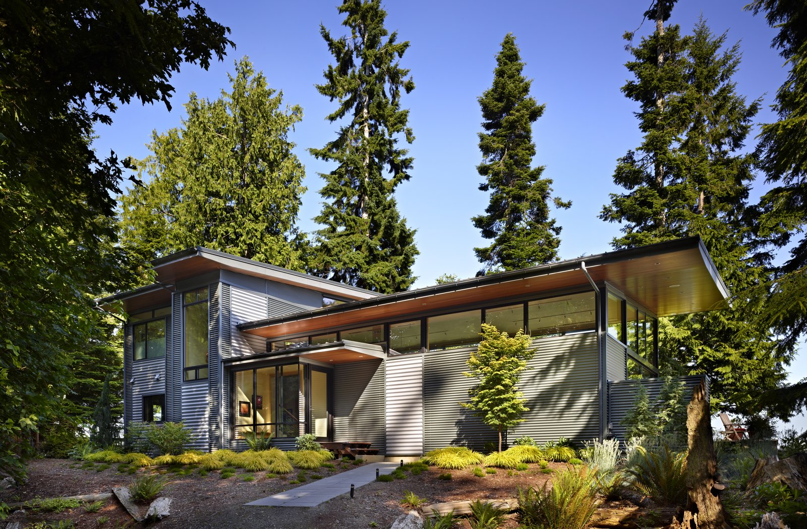 Exterior, Metal Siding Material, Metal Roof Material, House Building Type, and Shed RoofLine Exterior view of house on west side, showing entry walkway and front door  Port Ludlow House by FINNE Architects