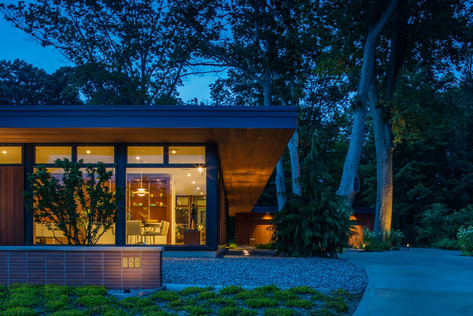 Outdoor Exterior walls are either glass or vertical cedar in-filled between structural framing, carefully chosen based on the flow and function within the home.  Pleasant Street Residence