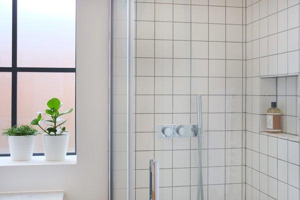 Square matte white tiles in bathrooms