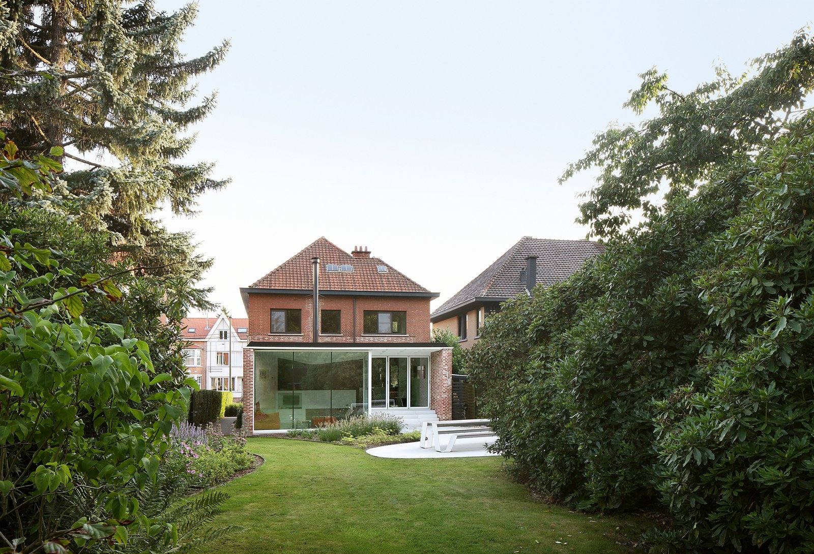 Outdoor, Gardens, Grass, Shrubs, Back Yard, Garden, Small, Flowers, Trees, Hardscapes, and Concrete New addition from outdoor garden  Best Outdoor Flowers Garden Photos from Leuven Residential Addition