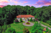 Modern home with Outdoor, Trees, Gardens, Garden, Grass, Front Yard, and Walkways. Cotton Candy Skies over NJ's most exclusive community Photo  of Prestigious  European-Inspired Mansion Just Outside NYC