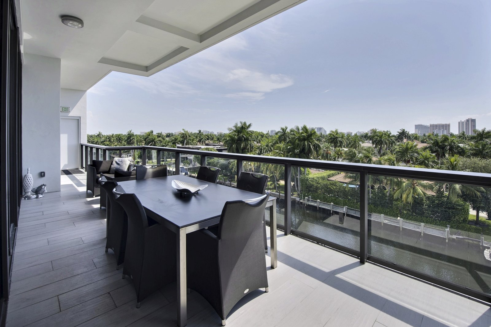 The home's wrap around terrace is an added bonus for enjoying coffee over the water morning or a glass of wine as the sun sets in the evening.   Luxury Florida Penthouse with Private Boat Slip Up for Auction