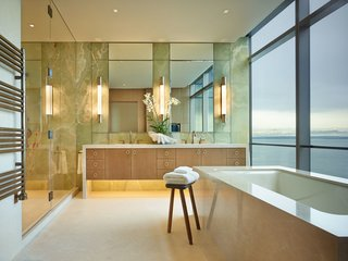 The onyx clad master bathroom overlooks Elliott Bay