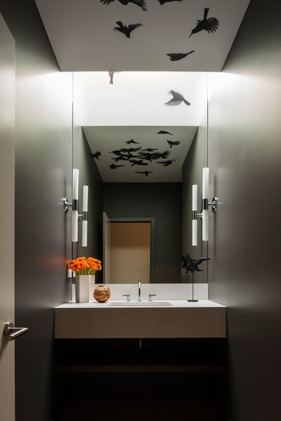 Wallcovering wraps the ceiling and skylight to reflect in the mirror