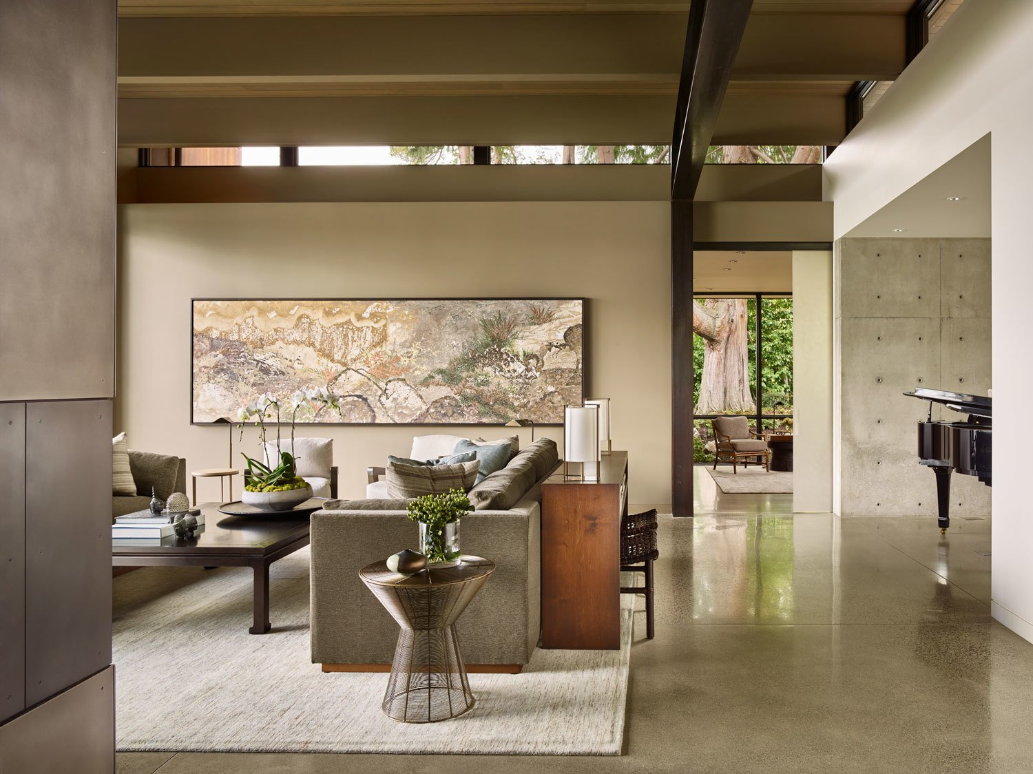 Living Room, Console Tables, End Tables, Recessed Lighting, Sofa, Chair, Coffee Tables, and Concrete Floor Concrete, steel and wood are used extensively through the interior  Union Bay Residence by NB Design Group