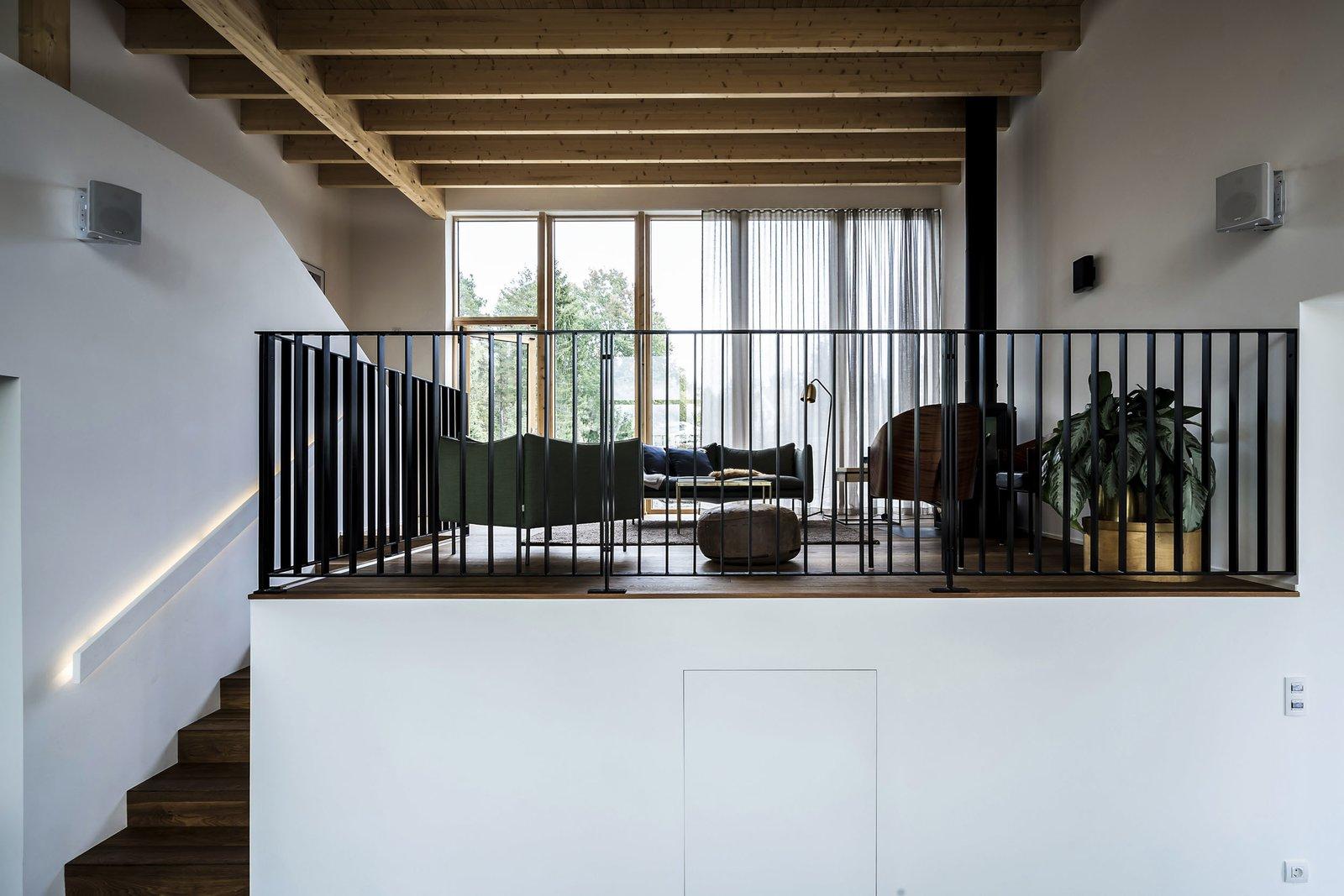 Living Room, Wood Burning Fireplace, Dark Hardwood Floor, Ceiling Lighting, and Sofa lounge hang out  Woodland house