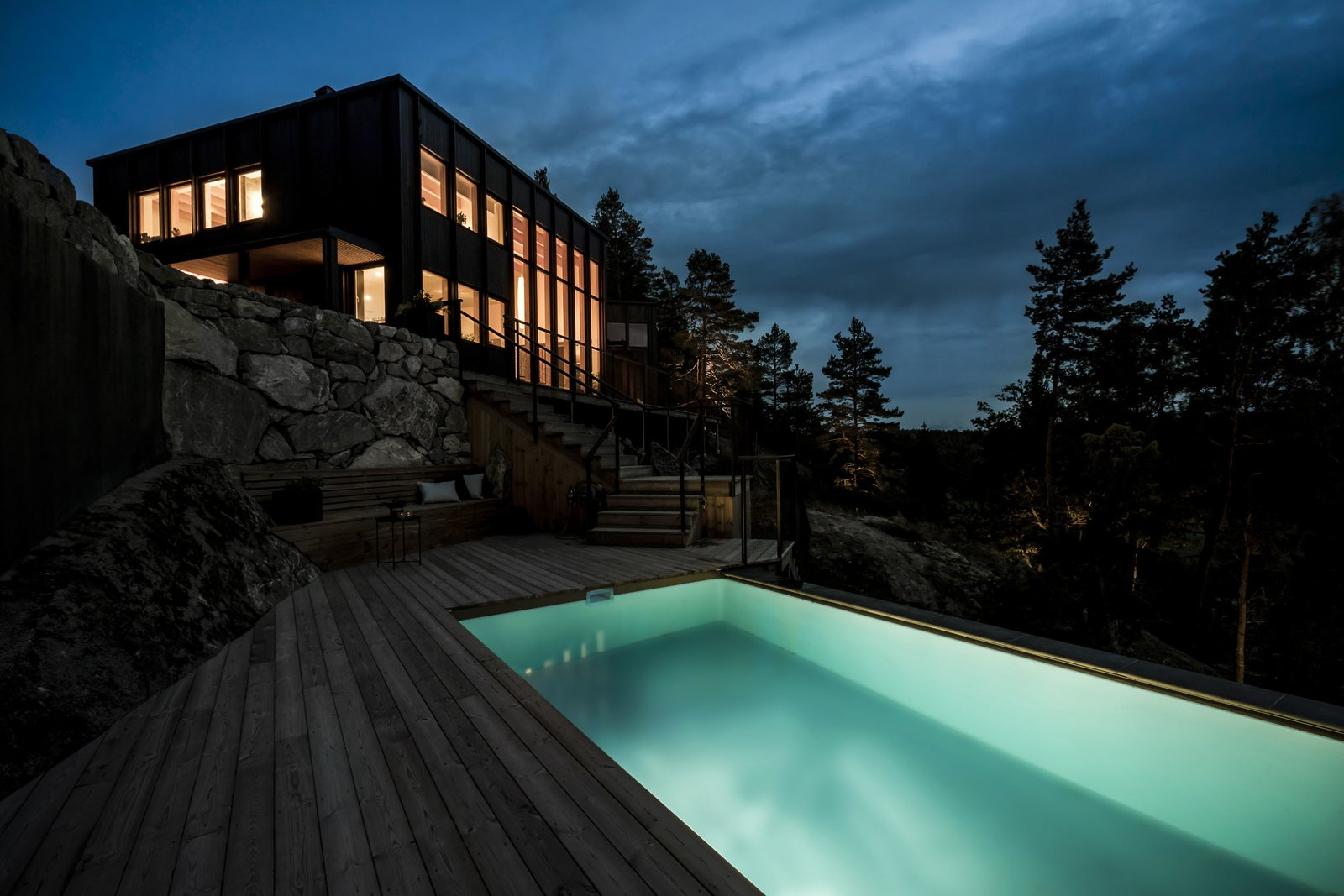 Exterior, Glass Siding Material, House Building Type, Wood Siding Material, and Flat RoofLine all in all; a superb feeling of being in tune with nature  Woodland house