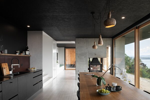 Together, Cumulus Studio and the Collins's opted for a transparent approach to architecture.  In the living areas, quality charcoal cabinetry and ceiling promote cozy interiors, at once harmonizing with and deflecting attention to the exceptional views.