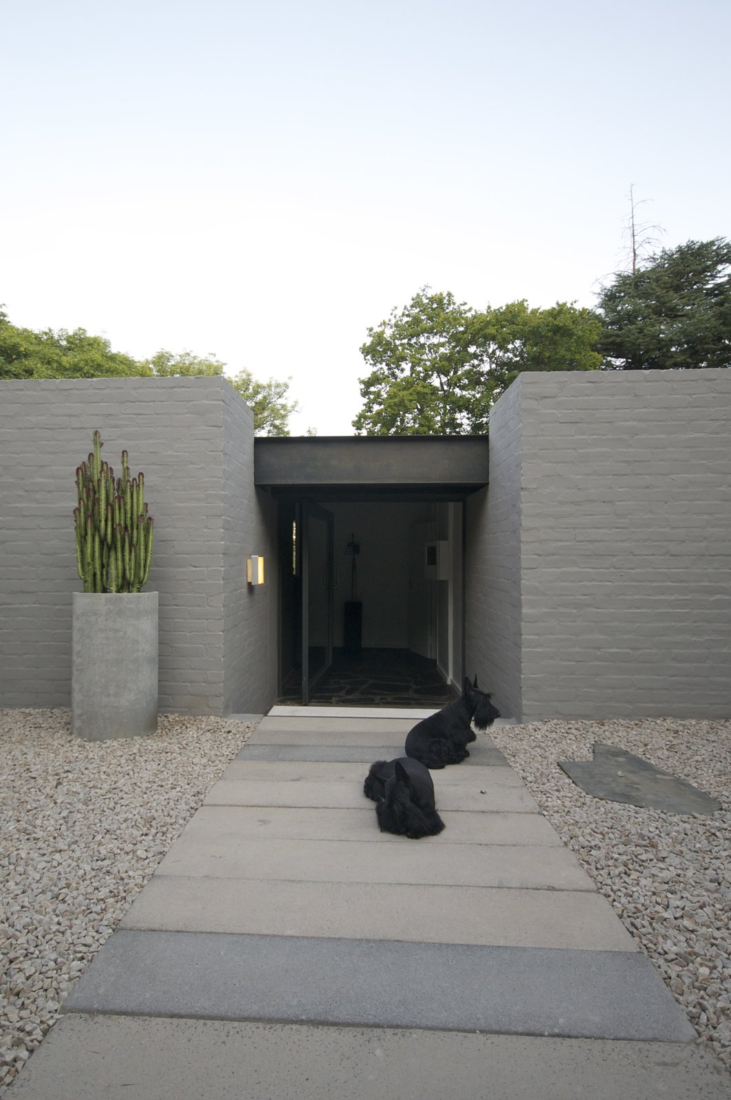 Exterior, House Building Type, Brick Siding Material, Shingles Roof Material, and Mid-Century Building Type front door of the house  Grey House