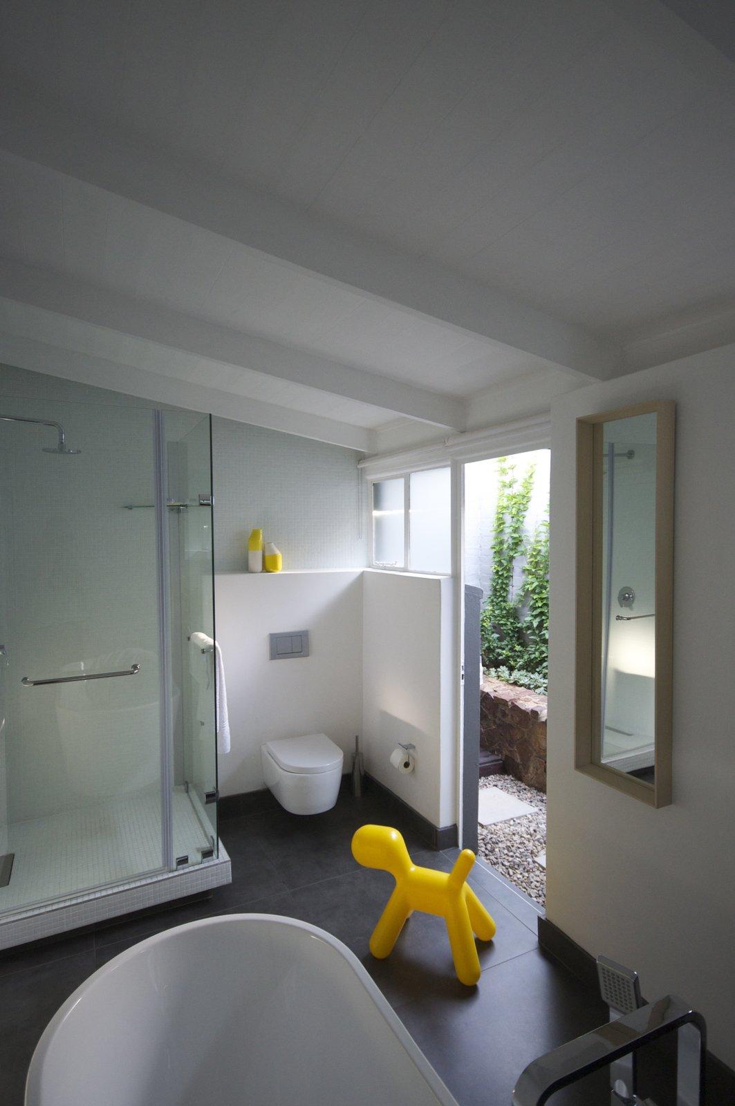 Bath Room, Freestanding Tub, Corner Shower, Mosaic Tile Wall, Enclosed Shower, One Piece Toilet, and Ceramic Tile Floor bathroom  Grey House