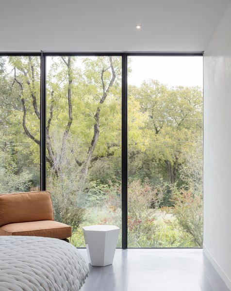 Within each bedroom, the architecture acts as a frame to the landscape beyond. The opening picture faces east towards the land and water conservation project across the street; it is 10' h x 15' w.