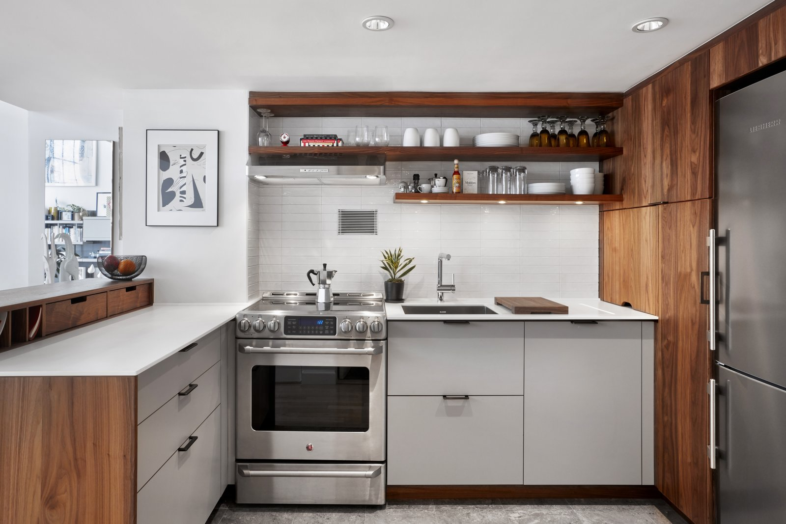 Kitchen, Recessed Lighting, Ceramic Tile Backsplashe, Subway Tile Backsplashe, Ceiling Lighting, Range, Refrigerator, Range Hood, Wood Cabinet, Drop In Sink, and Wine Cooler Refrigerator by Liebherr Dishwasher by Bosch Wine Refrigerator by Summit  4th Ave./Union Square Apartment