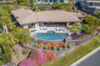 Modern home with Outdoor, Large Pools, Tubs, Shower, Hardscapes, Stone Patio, Porch, Deck, Shrubs, Large Patio, Porch, Deck, Swimming Pools, Tubs, Shower, Boulders, Landscape Lighting, Slope, Gardens, Stone Fences, Wall, Infinity Pools, Tubs, Shower, Horizontal Fences, Wall, Retaining Fences, Wall, and Back Yard. Thoughtful design continues outside of the entire site plan. Photo  of Hawaii Architect's Home in Keauhou Estates