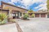 Modern home with Outdoor, Hanging Lighting, Front Yard, Stone Patio, Porch, Deck, Concrete Patio, Porch, Deck, Walkways, Shrubs, and Landscape Lighting. Beautiful entrance with custom leaded glass welcomes you home. Photo 2 of Hawaii Architect's Home in Keauhou Estates