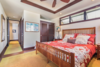Modern home with Bedroom, Night Stands, Bed, Recessed Lighting, Rug Floor, Dark Hardwood Floor, and Table Lighting. One of two guest suites. Photo 11 of Hawaii Architect's Home in Keauhou Estates