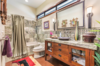 Modern home with Bath Room, Recessed Lighting, Full Shower, Wall Lighting, One Piece Toilet, Granite Counter, Vessel Sink, Stone Tile Wall, Drop In Tub, and Rug Floor. Bath for adjoining guest suite. Photo 12 of Hawaii Architect's Home in Keauhou Estates