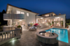 The home from the pool deck at night.  Photo 2 of Mediterranean Estate in Hawaii Loa Ridge modern home