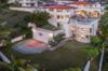 Property from the back corner Photo 3 of Mediterranean Estate in Hawaii Loa Ridge modern home