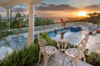 The pool of this palatial Mediterranean style home at sunset Photo 4 of Mediterranean Estate in Hawaii Loa Ridge modern home