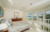 Bedroom suite under the pool deck with expansive floor to ceiling windows Photo 9 of Mediterranean Estate in Hawaii Loa Ridge modern home
