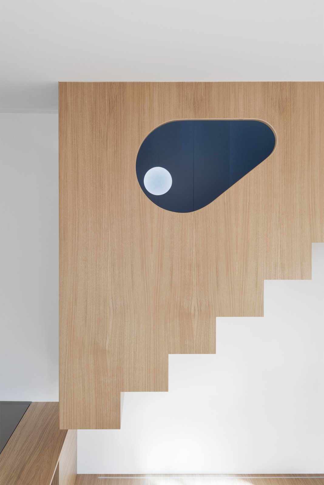 Staircase, Wood Railing, and Wood Tread The eye-shaped hole of the stairs volume  Into the Woods