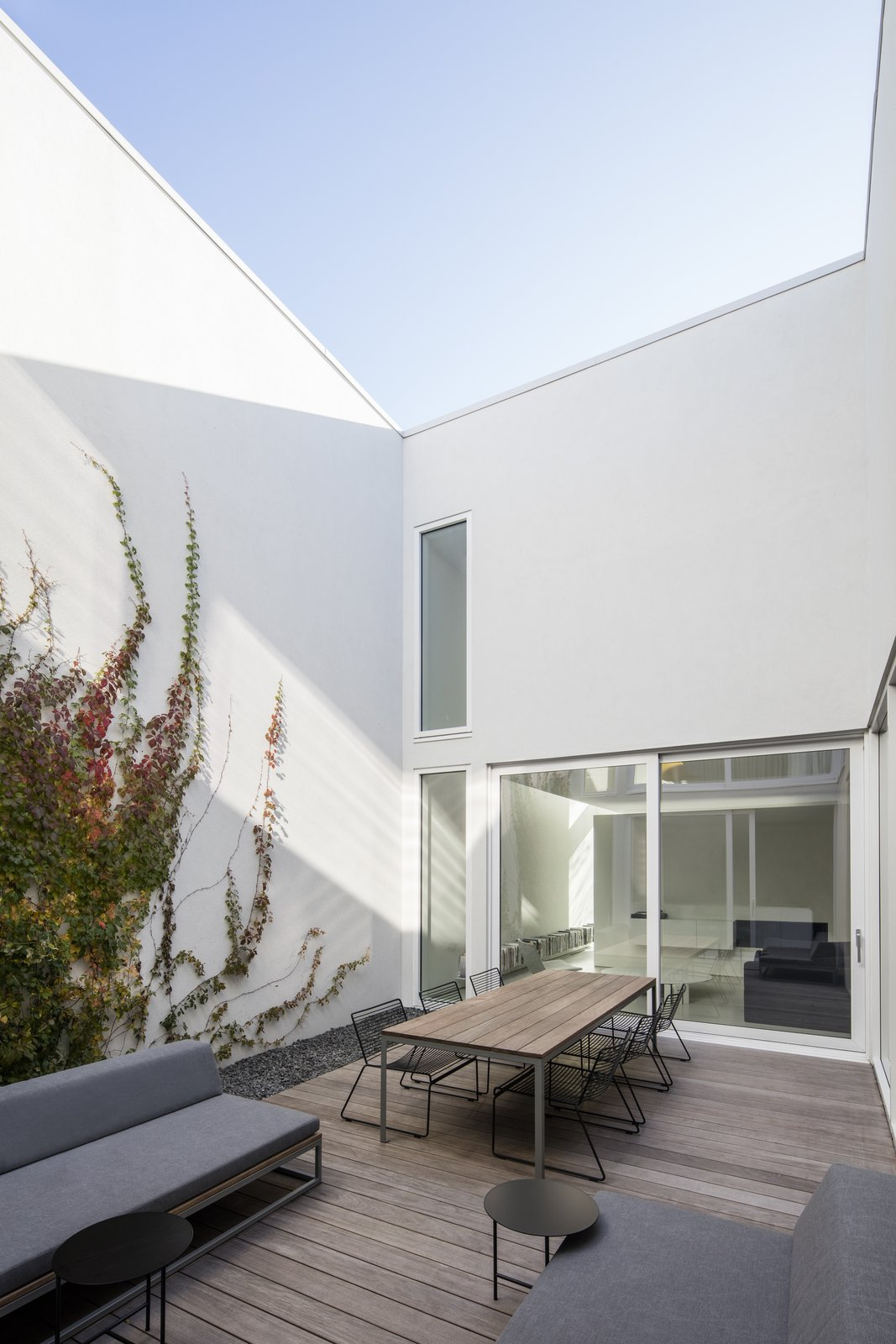 Outdoor, Raised Planters, Wood Patio, Porch, Deck, Garden, and Hardscapes Central courtyard. The white colour, omnipresent, acts as a reflective surface and complexifies light effects.  Best Photos from The House on Drolet Street
