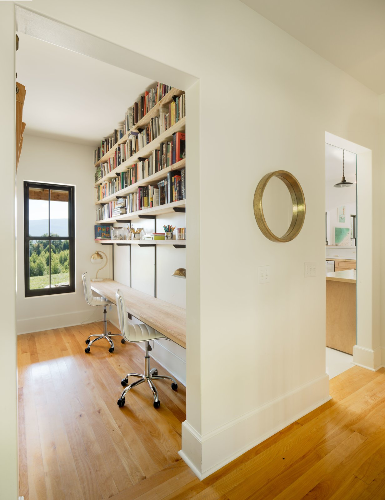 Office, Lamps, Shelves, Chair, Medium Hardwood Floor, Study Room Type, and Desk Study Desks with mountain view.  Photo 3 of 6 in 6 Ways to Turn Your Home Office Into a Distraction-Free Zone from Contemporary Vermont Farmhouse