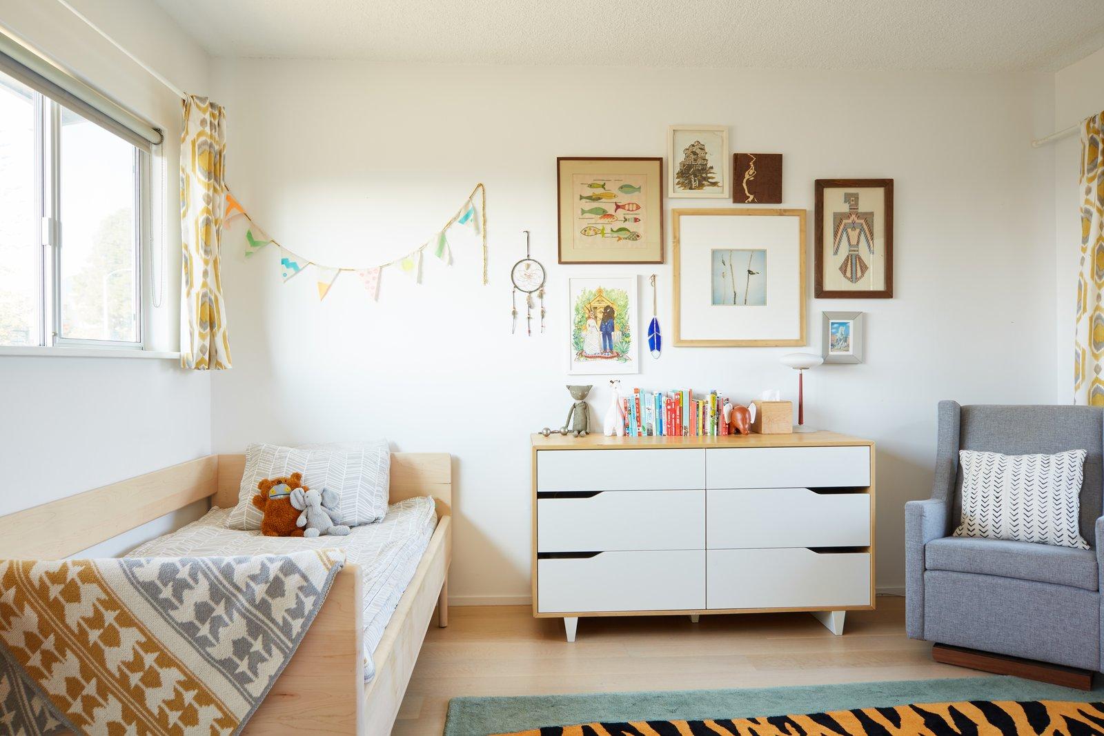 Kids, Bed, Light Hardwood, Bedroom, Chair, Dresser, Toddler, Neutral, and Rug Kids Bedroom  Kids Dresser Light Hardwood Chair Photos from Midcentury Dream House
