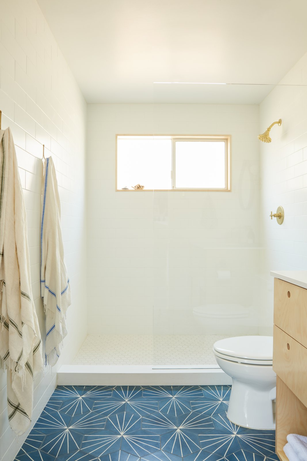 Bath Room, One Piece Toilet, Open Shower, Ceramic Tile Floor, Laminate Counter, Ceiling Lighting, and Subway Tile Wall Bathroom  Photos from Midcentury Dream House
