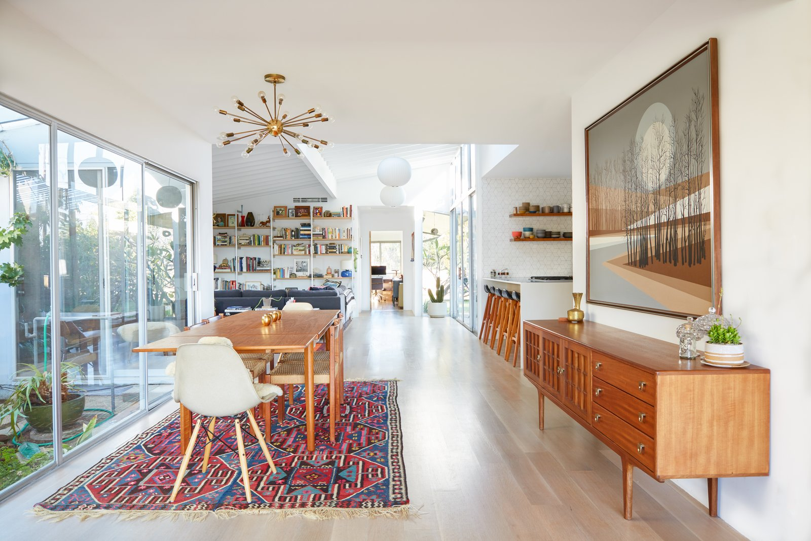 Dining, Chair, Storage, Table, Light Hardwood, Ceiling, and Rug Dining Room Looking into Kitchen and Family Room  Best Dining Light Hardwood Rug Ceiling Table Photos from Midcentury Dream House