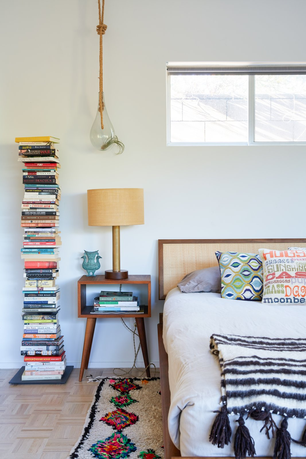 Bedroom, Bed, Night Stands, Table Lighting, Light Hardwood Floor, and Rug Floor Detail of Guest Bedroom  Midcentury Dream House