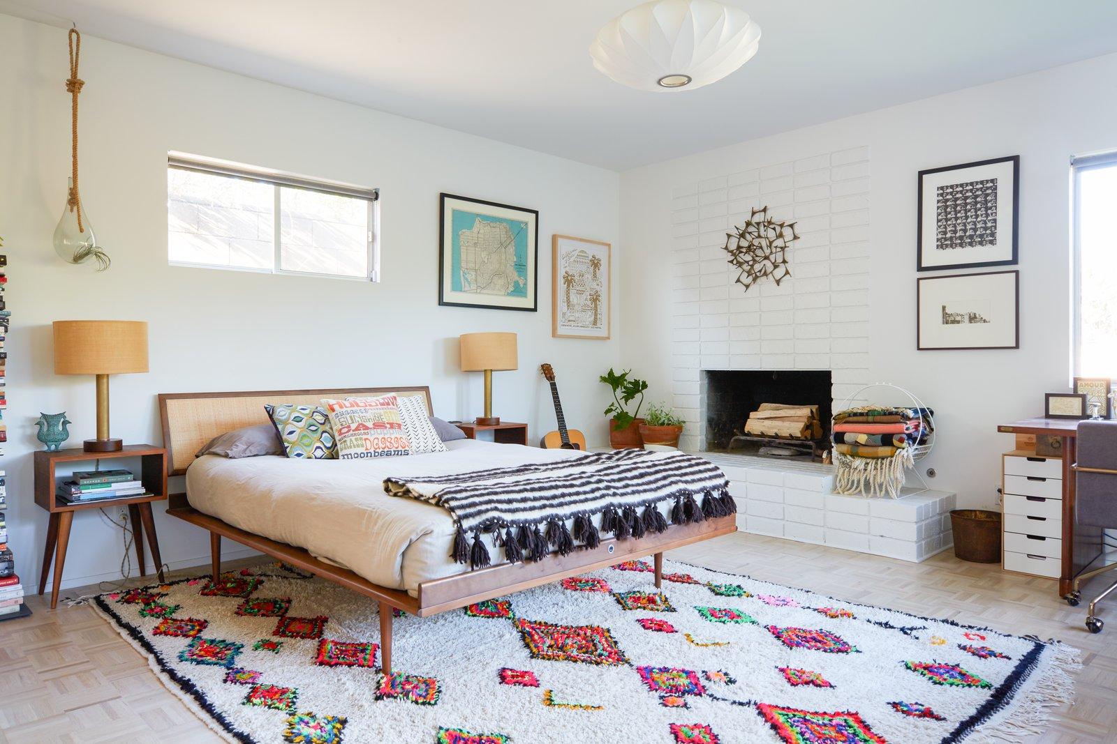 Bedroom, Lamps, Light Hardwood Floor, Night Stands, Bed, Rug Floor, Pendant Lighting, and Chair Guest Bedroom  Midcentury Dream House
