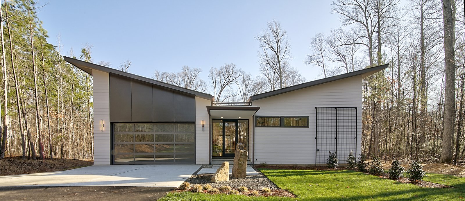 Exterior, House Building Type, Flat RoofLine, Mid-Century Building Type, Shed RoofLine, Butterfly RoofLine, Wood Siding Material, and Shingles Roof Material Exterior Front  House 23 by Zipper Architecture