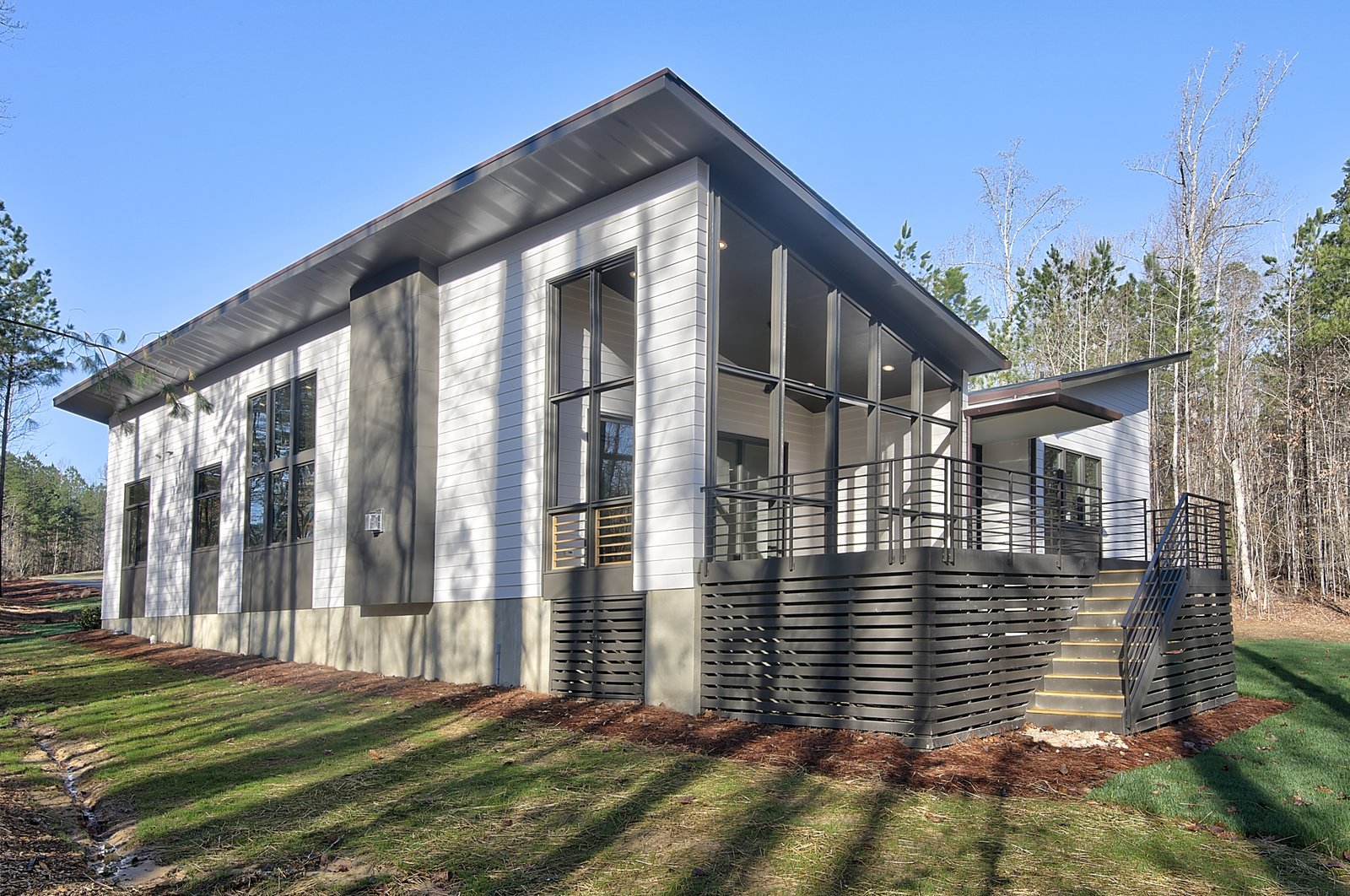 Exterior, Shed RoofLine, Flat RoofLine, Shingles Roof Material, Butterfly RoofLine, Wood Siding Material, Mid-Century Building Type, and House Building Type Exterior Rear  House 23 by Zipper Architecture