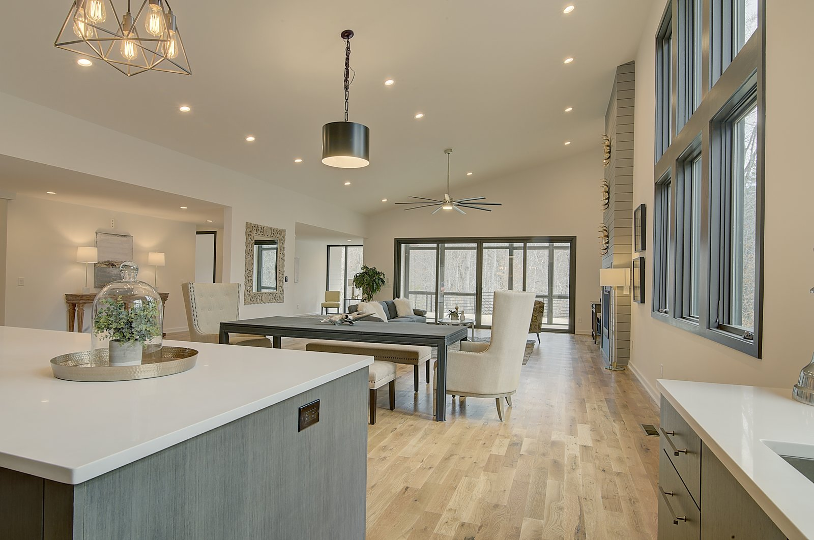 Dining Room, Pendant Lighting, Light Hardwood Floor, Recessed Lighting, Table, Bench, and Chair Kitchen - Looking toward Living Area  House 23 by Zipper Architecture