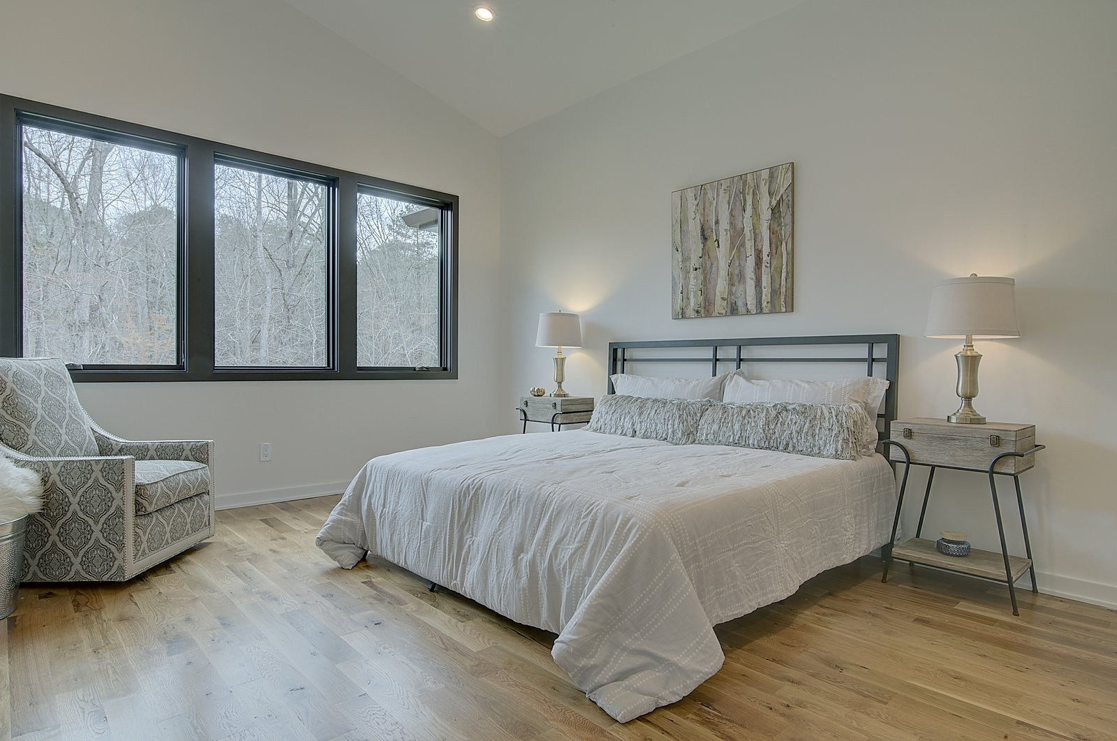 Bedroom, Night Stands, Chair, Recessed Lighting, Bed, and Light Hardwood Floor Master Bedroom  House 23 by Zipper Architecture