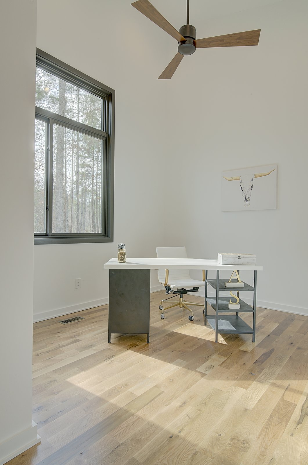 Office, Chair, Study Room Type, Light Hardwood Floor, and Desk Office / Guest Bedroom  House 23 by Zipper Architecture