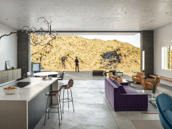 Using a natural material palette helps Ridge Mountain Residence by Ehrlich Yanai Rhee Chaney Architects blend in with its surroundings: the concrete complements the light browns and tans of the surrounding mountains, while Cor-ten steel cladding provides a naturally weathering material.