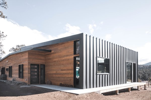 A standing seam metal roof wraps down the exterior wall of the home to protect against the harsh winds of the terrain.