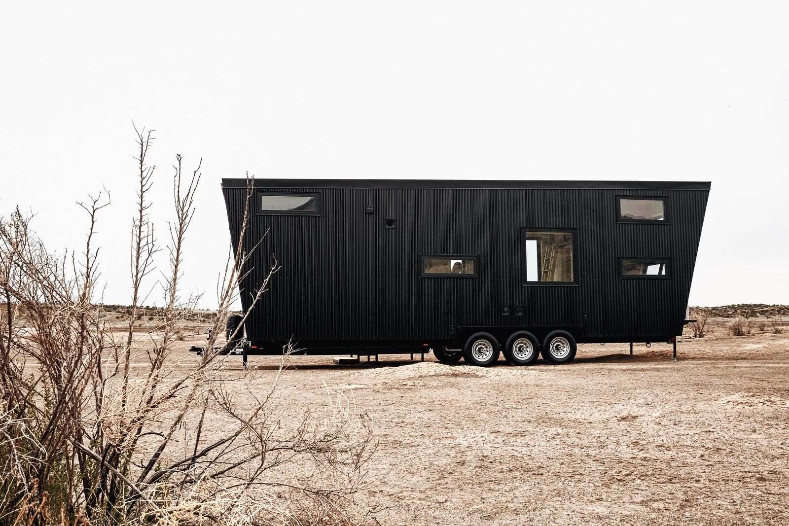 "Exterior, Metal Siding Material, Tiny Home Building Type, and Camper Building Type ""Psychology and emotional response play big roles when you're living in such a relatively small space, so subtle moves can have a large impact."" Whether one is looking for a weekend retreat or a mobile home equipped for an extended sojourn, the two founders have spent years researching and testing so that this model can be the ideal solution for all.    Photo 3 of 14 in This Sleek Travel Trailer Is Practically a Cabin on Wheels from Land Ark RV - Drake"