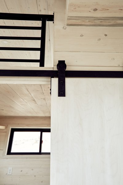 A closer look at the white-washed walls and sleek black hardware.