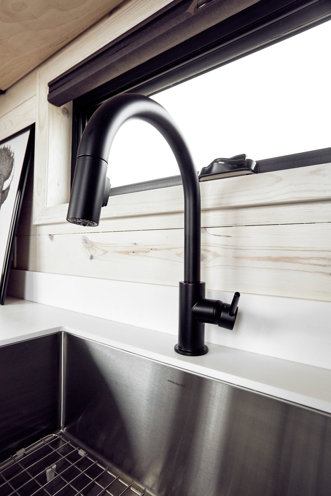 Large, stainless under-mounted sink makes real cooking and cleaning as easy as it is in a typical house.  Land Ark RV - Drake by Brian Buzarde