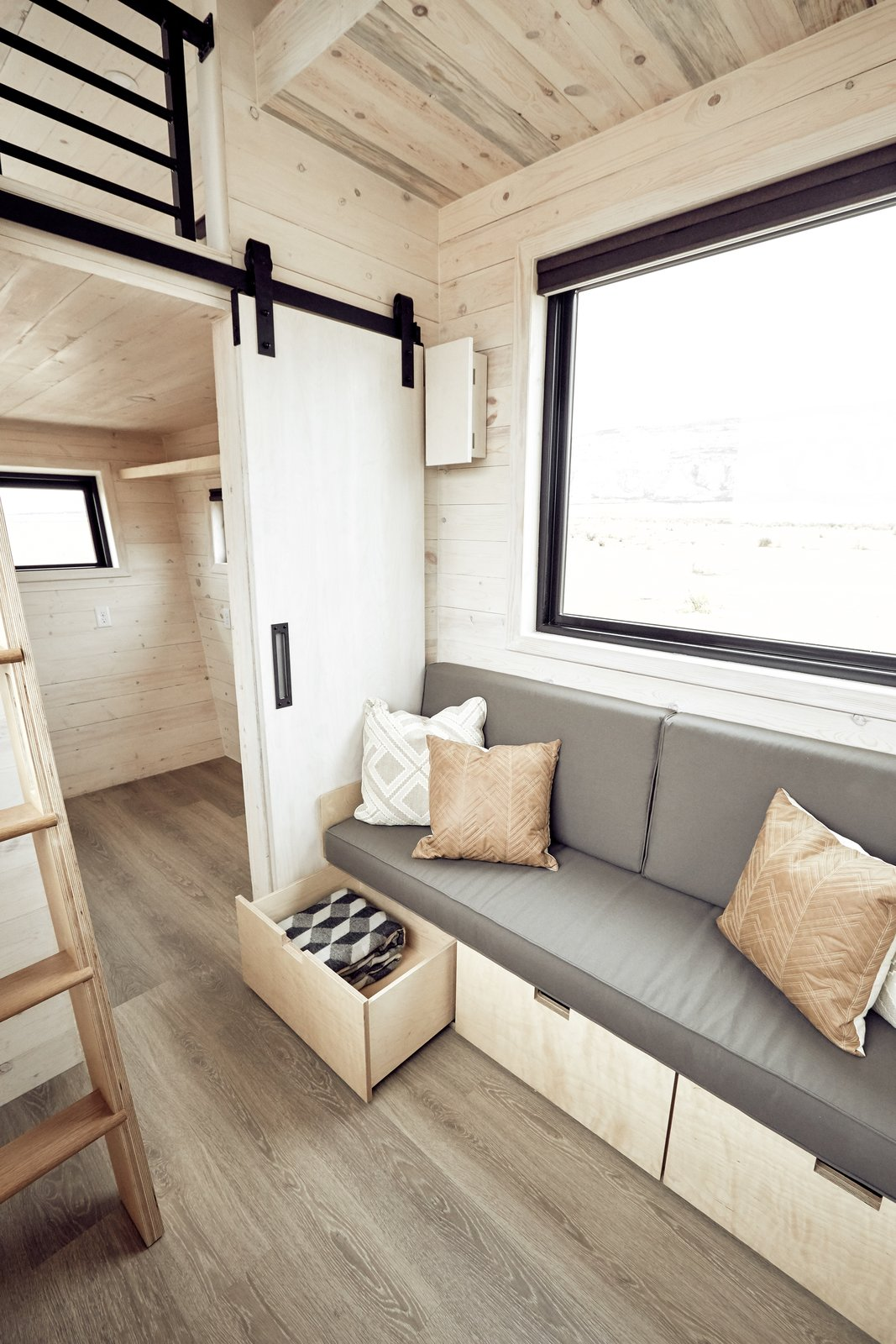 Storage Room This built-in custom couch offers ample storage underneath.    Land Ark RV - Drake by Brian Buzarde