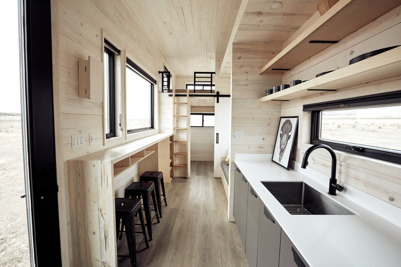 Kitchen, Ceiling Lighting, and Undermount Sink Ample natural light enters via the multiple windows. As you can see above, stylish cabin vibes flood the home.    Photo 7 of 14 in This Sleek Travel Trailer Is Practically a Cabin on Wheels from Land Ark RV - Drake