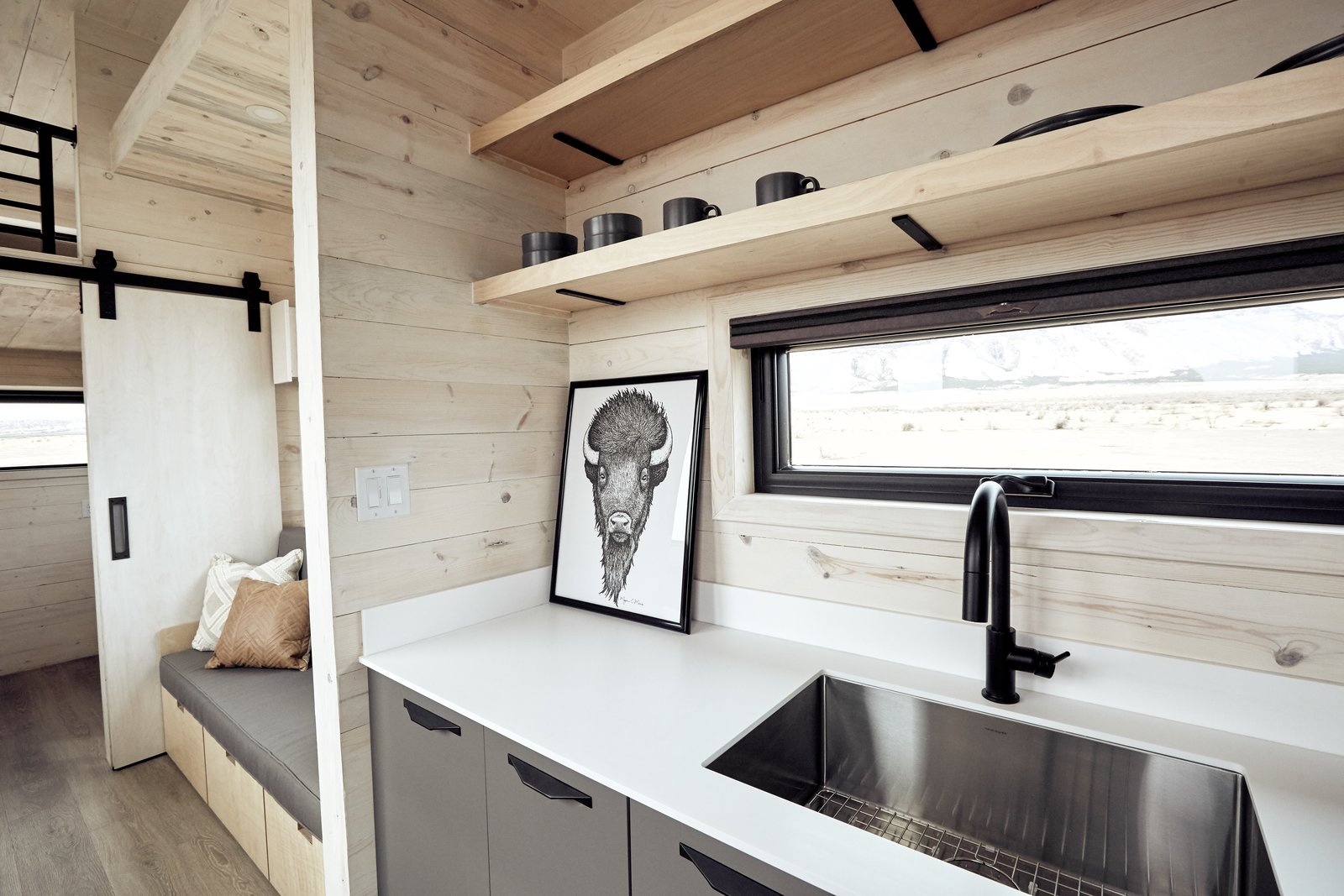 Kitchen and Undermount Sink The kitchen and living areas are integrated together inside the large main room, yet each can still function as its own autonomous zone.    Photo 8 of 14 in This Sleek Travel Trailer Is Practically a Cabin on Wheels from Land Ark RV - Drake