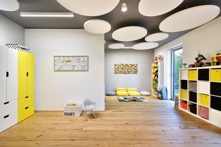 therapy room/ playroom with round acoustic ceiling panels